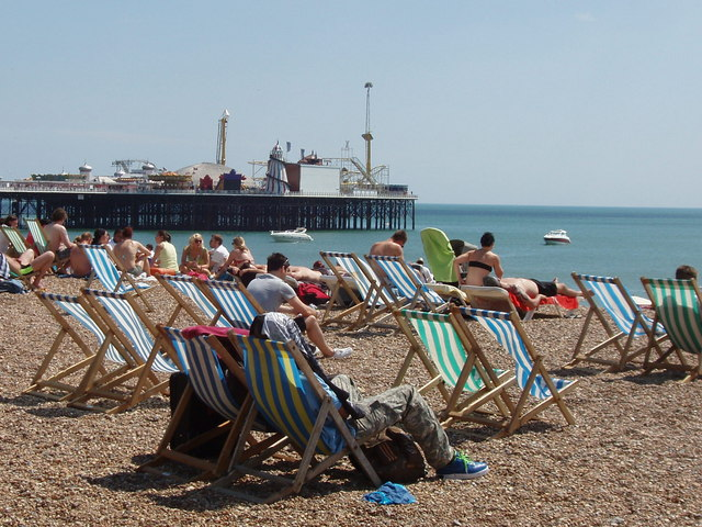 Deckchairs_and_sunbathers_on_a_sunny_Sunday,_Brighton_beach_-_geograph.org.uk_-_1338763